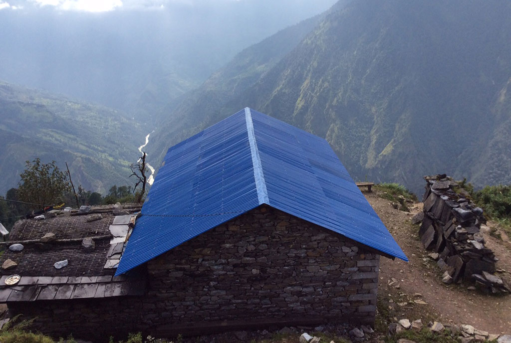 Distributing tin roofs in villages.